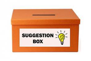 A photo of an orange suggestion box.