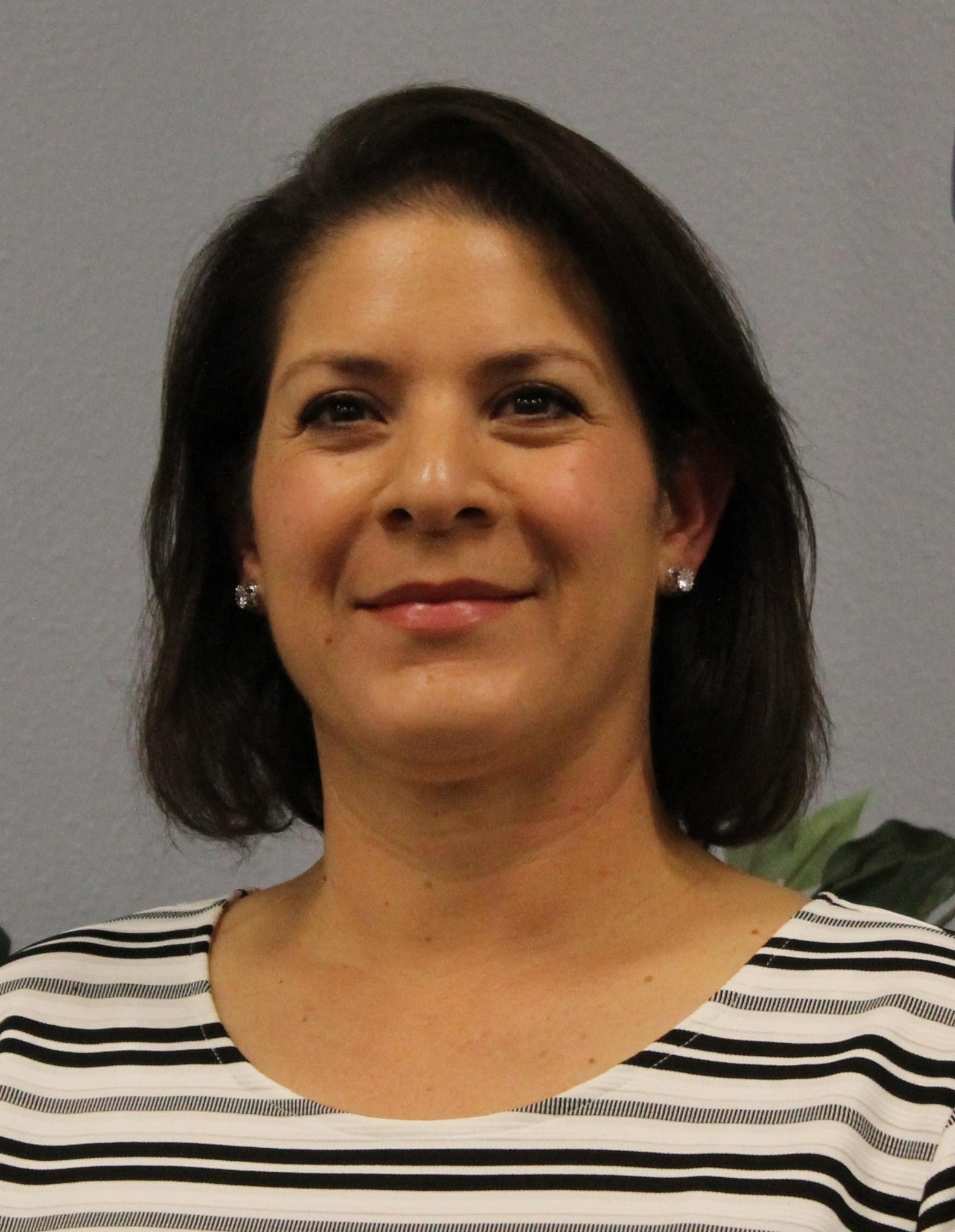 Dr. Claudia Moya-Tanner, President