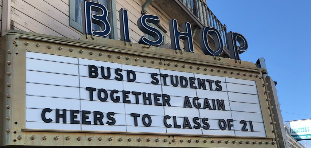 """marquee that reads """"BUSD Students Together Again: Cheers to Class of 21"""""""