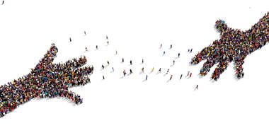 Birds eye view of two groups of people making the shape of two hands
