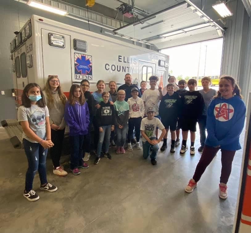 students taking a tour of a factory