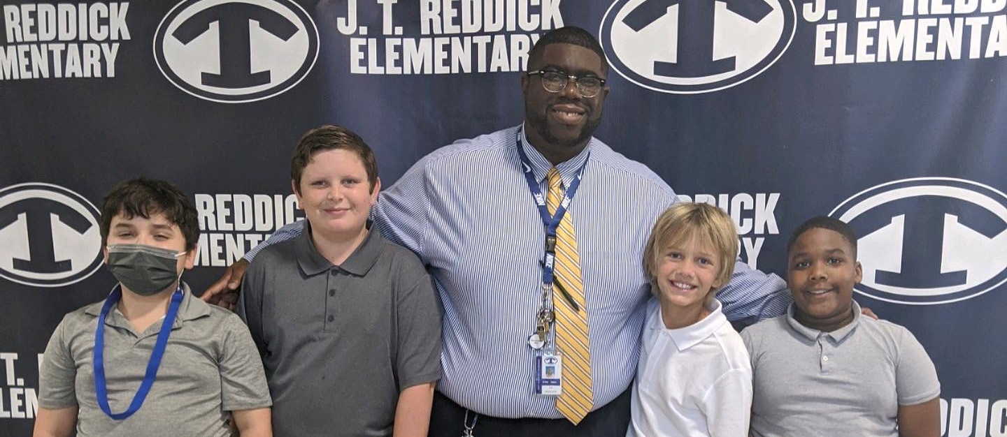 principal with students