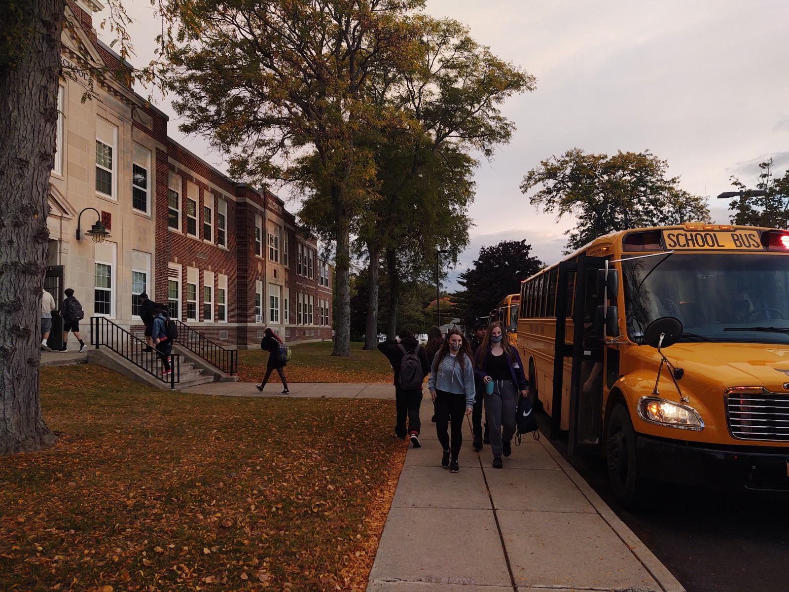 Students in the bus loop