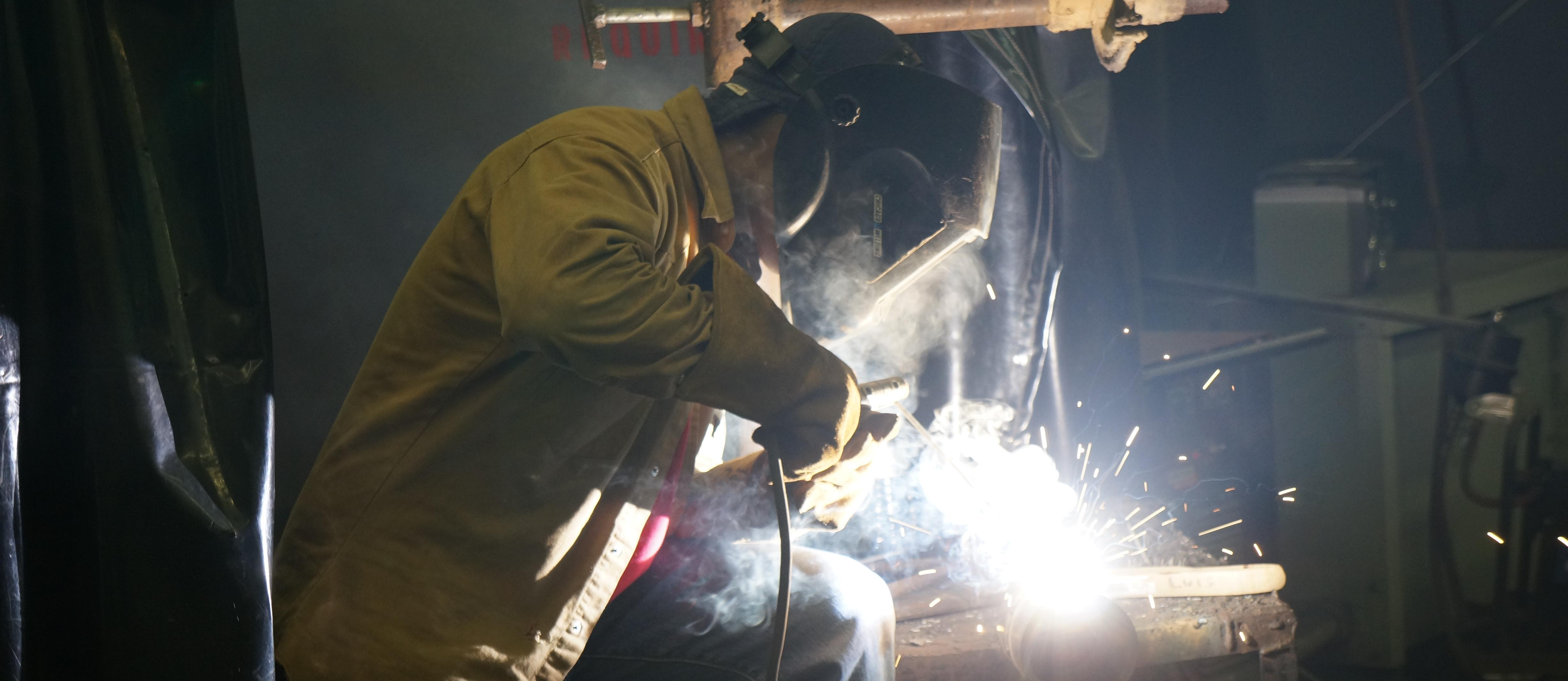 Student practices their welding