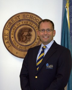 Board President, Mr. Earle Dempsey