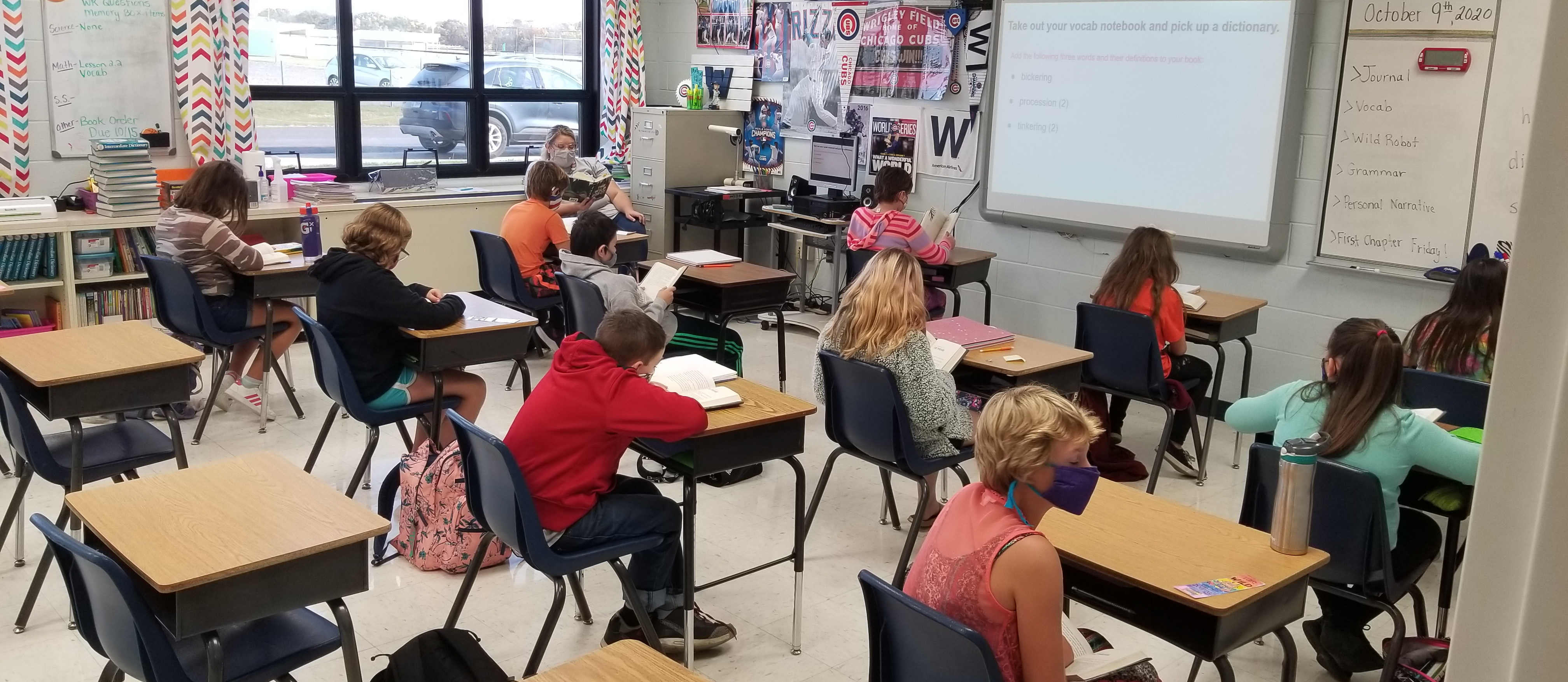 middle school students  learning in the classroom