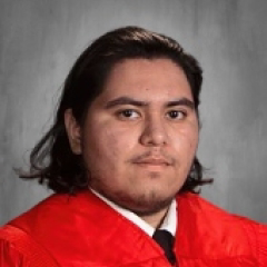 Cap and Gown Photo of Raul Porras