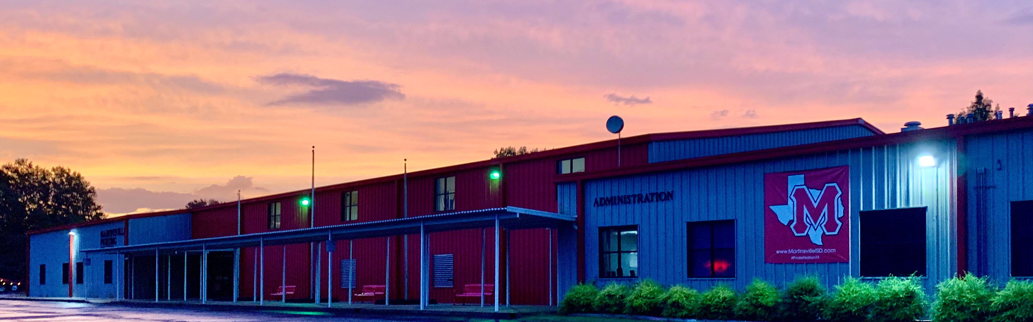 School building with sunrise in the background