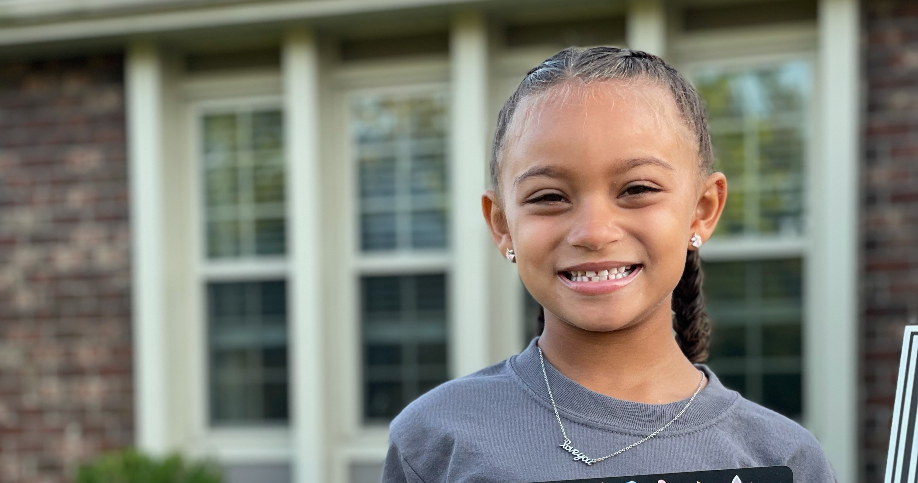 Student smiling on the first day of school.