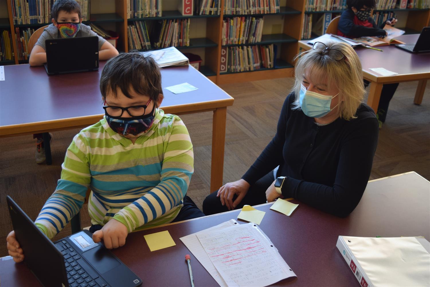Librarian helping students