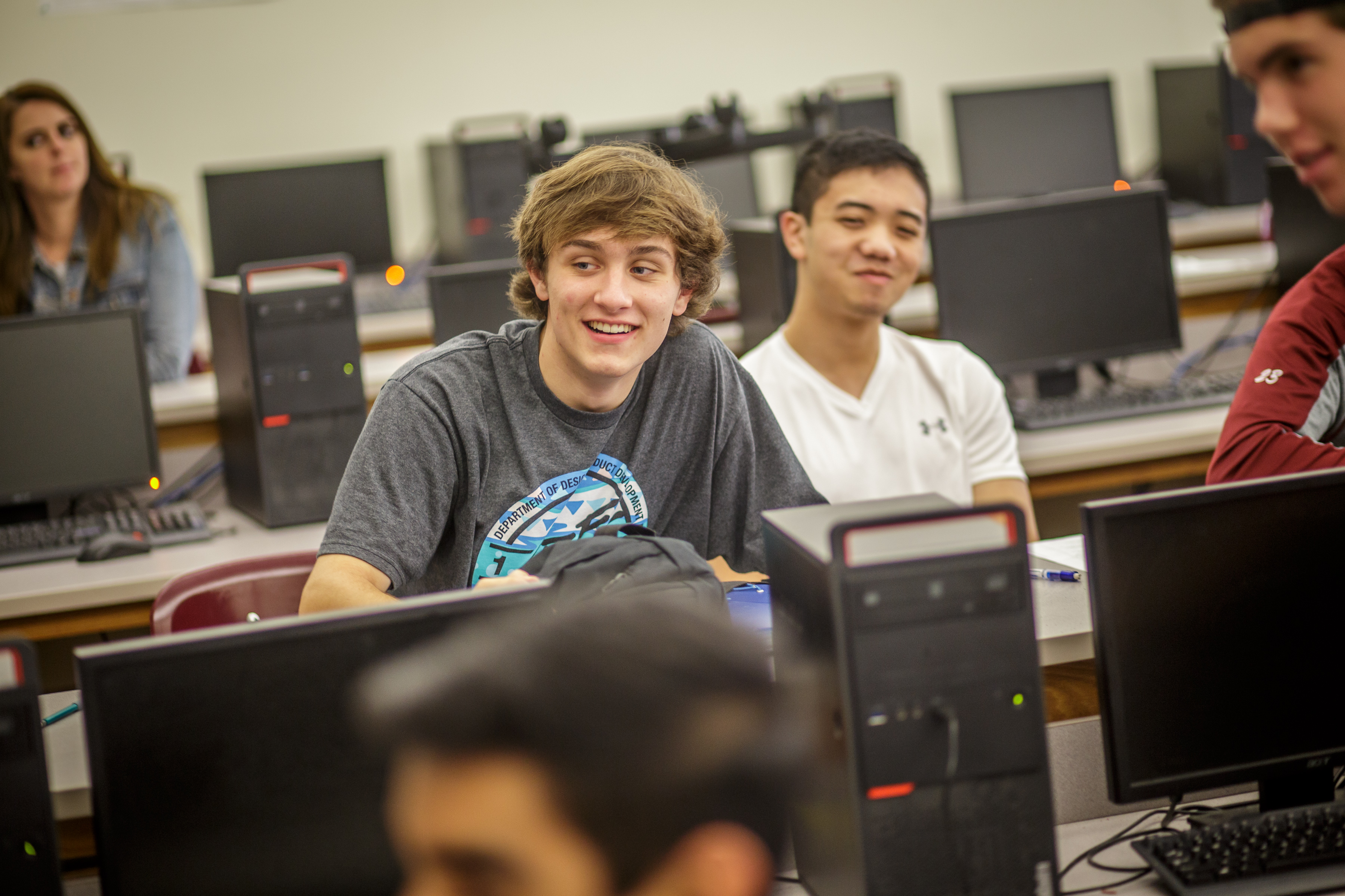 Students at a desk.