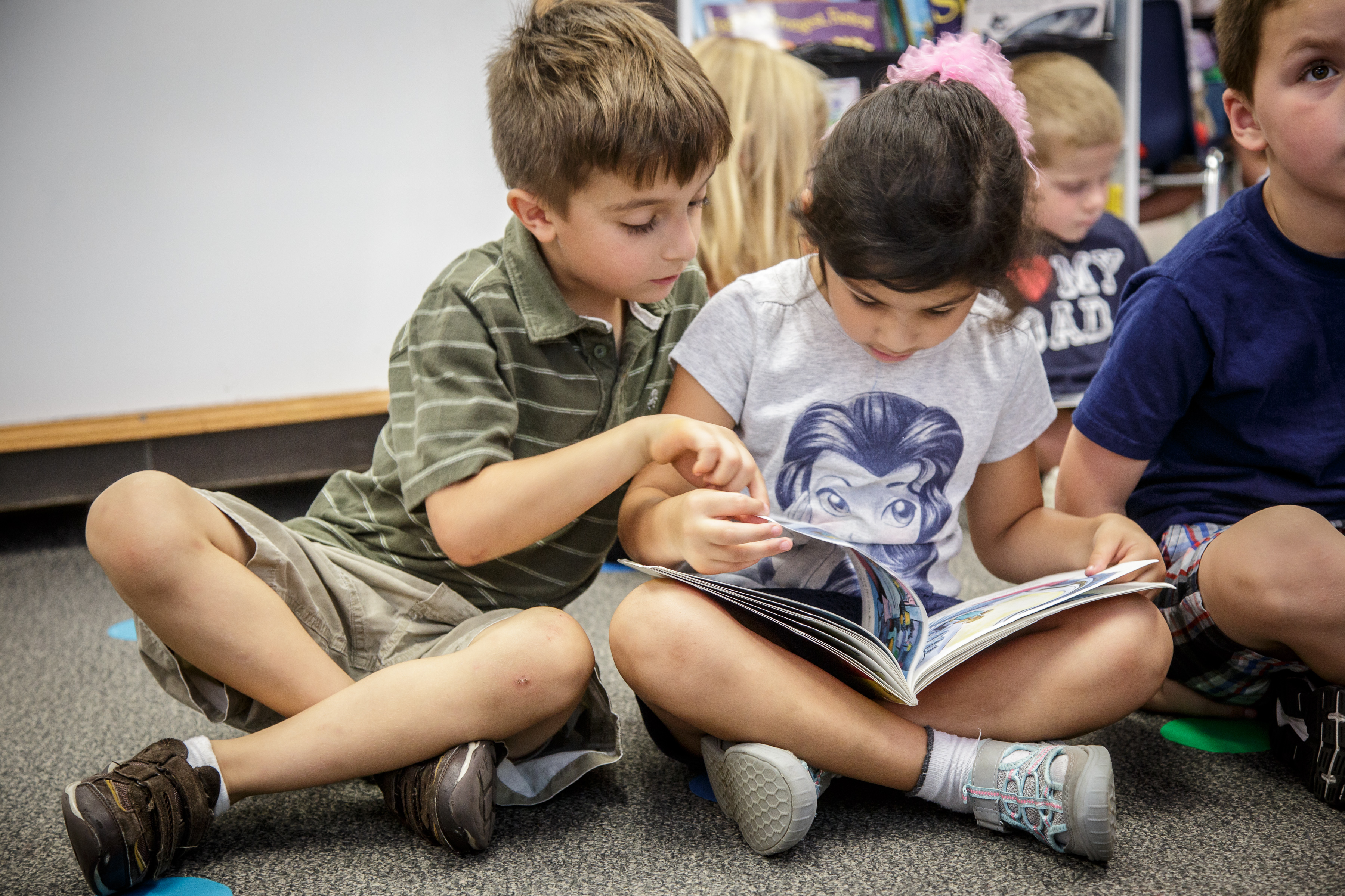 Students reading books.