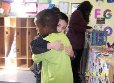 Photo of kids hugging.