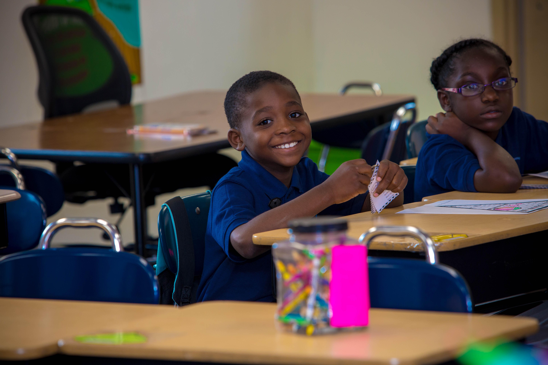 Smiling student at desk