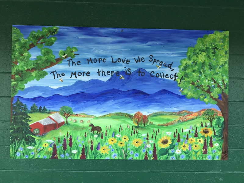 "a painting that reads ""The more love we spread, the more there is to collect"""