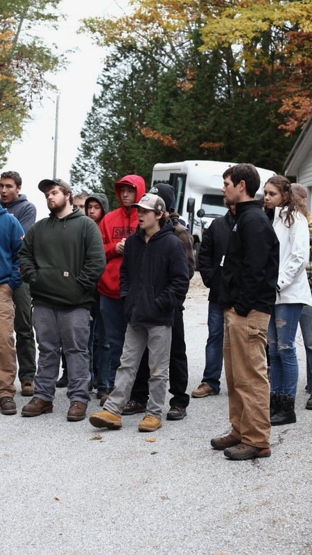 Students gathered outside looking at something out of the frame