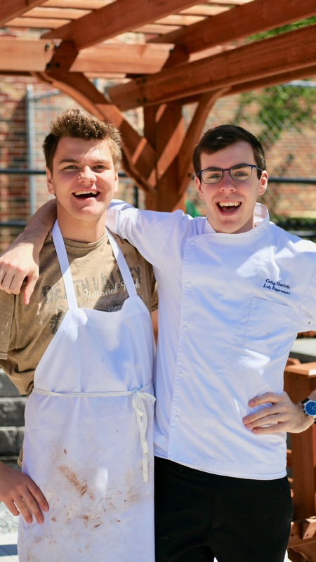 2 student chefs smiling for a picture