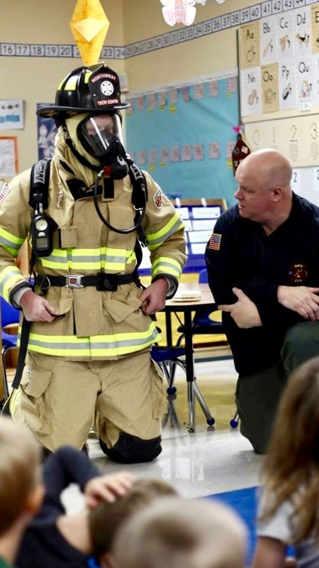 2 firemen talking to the students