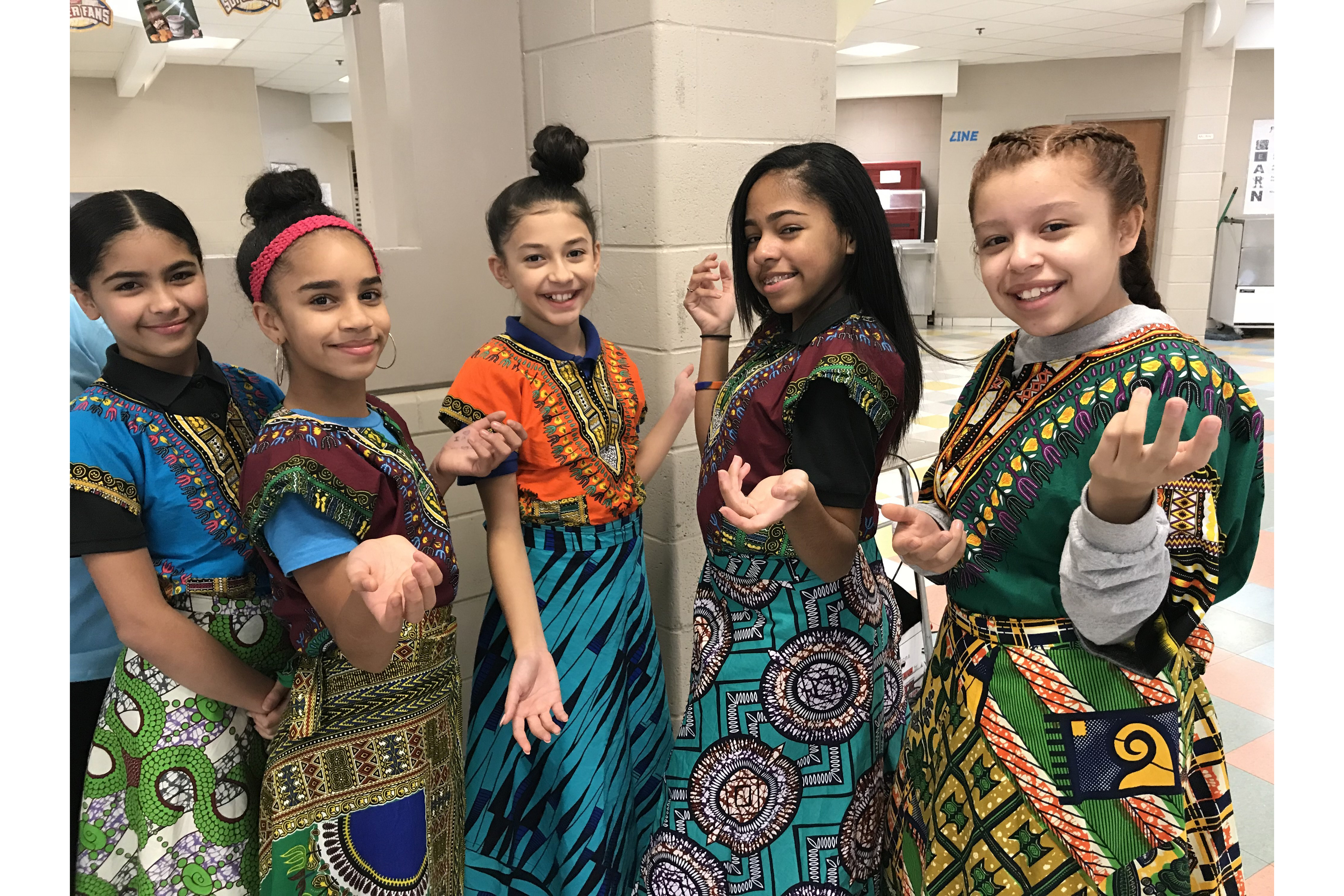 Female students in traditional dresses