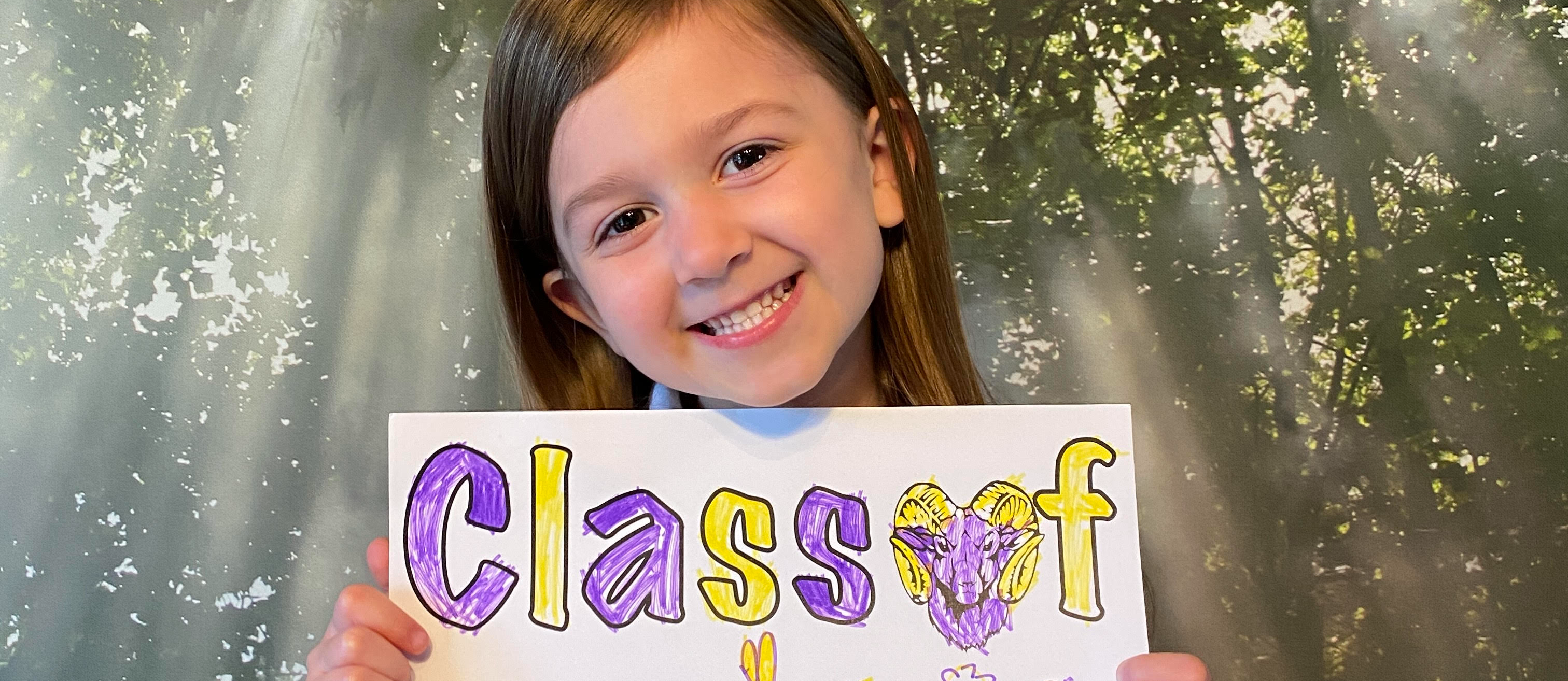 Student with Class of 2034 sign