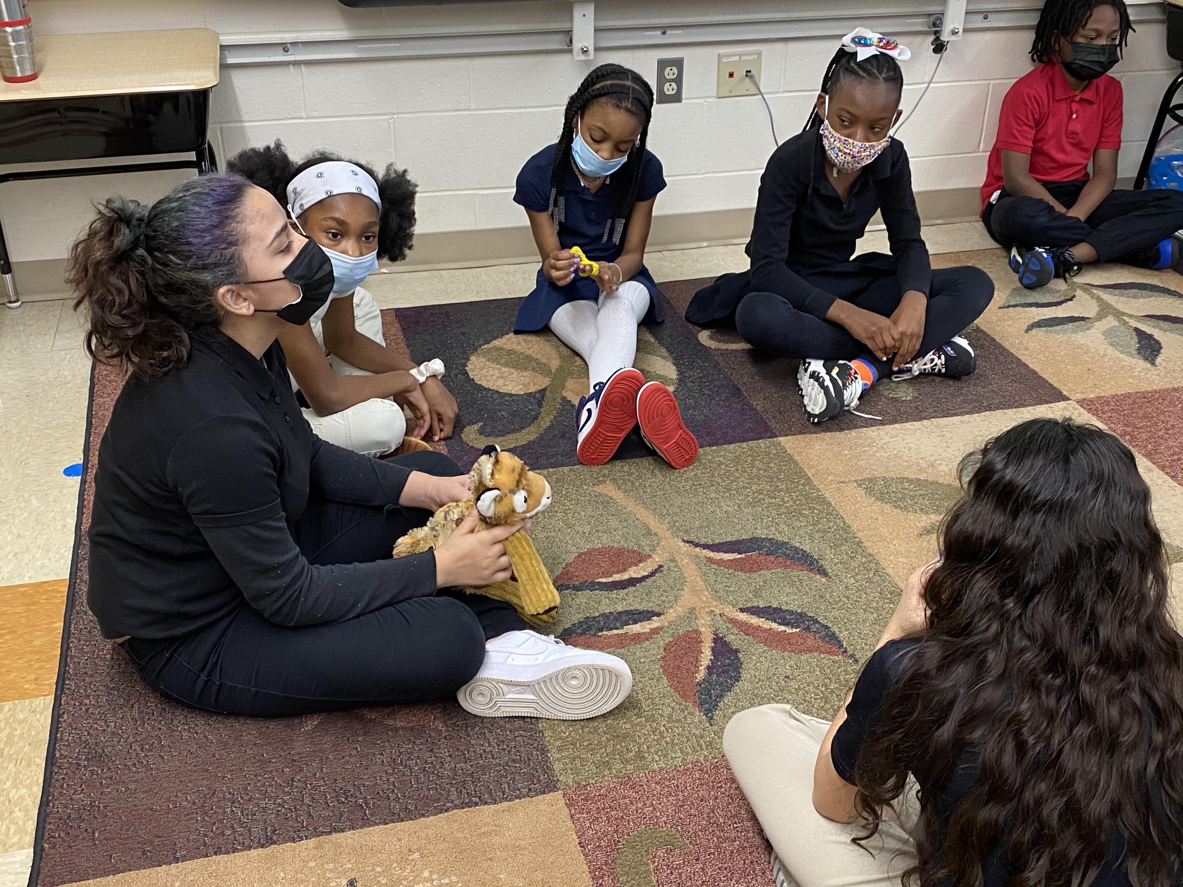 students in restorative circle in room
