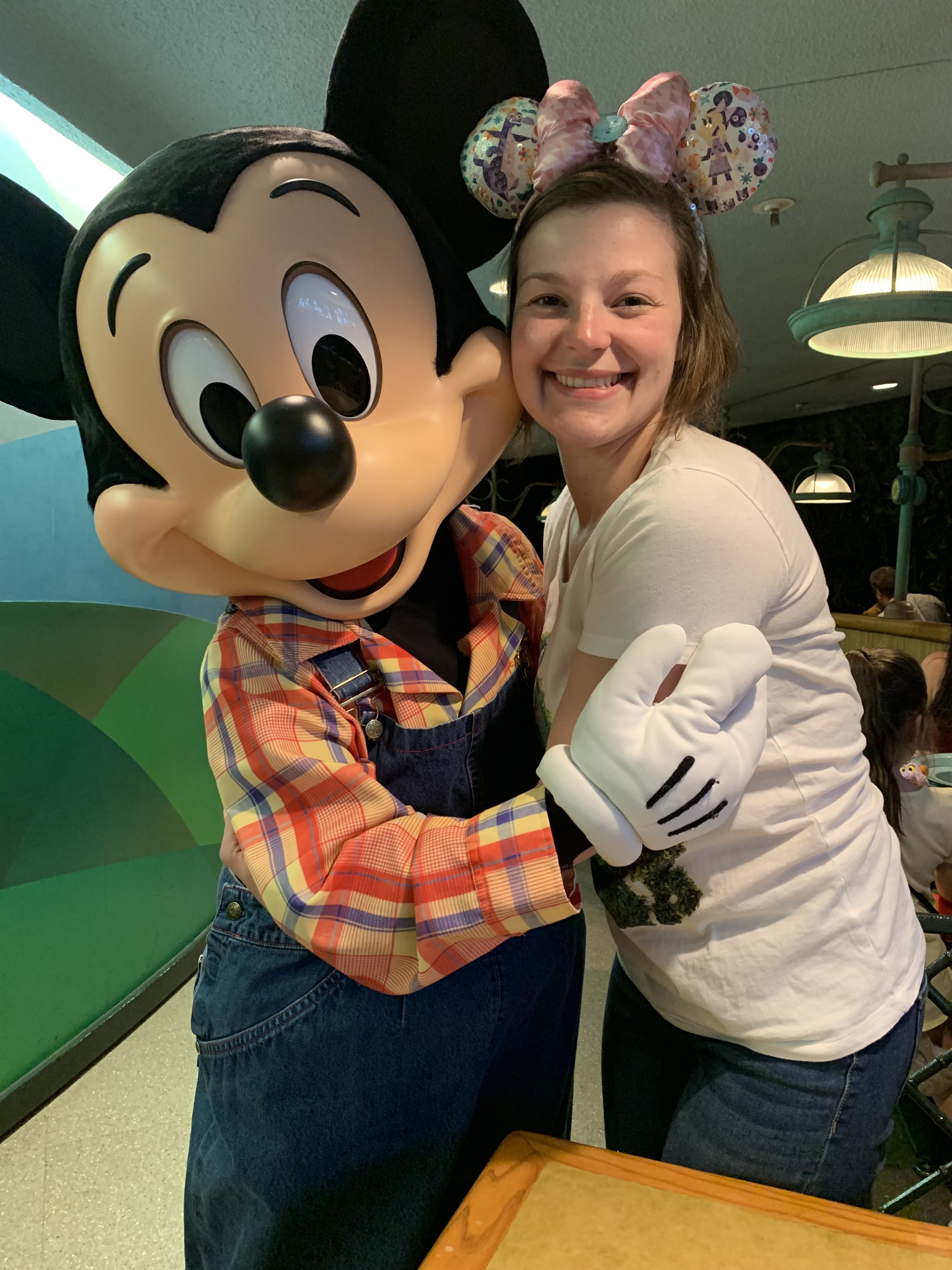 Ms. Folsom, grade 3 teacher with Mickey Mouse