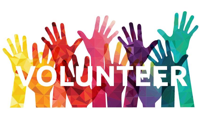 multi color hands raised to volunteer