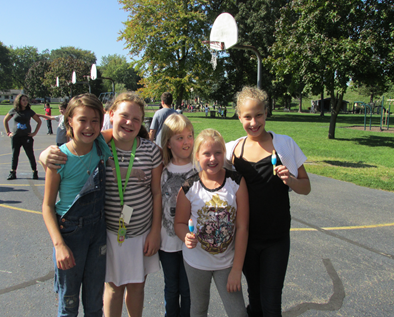 Kids out in recess and enjoying popsicles