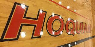 Gym floor image with Hoquiam in it.