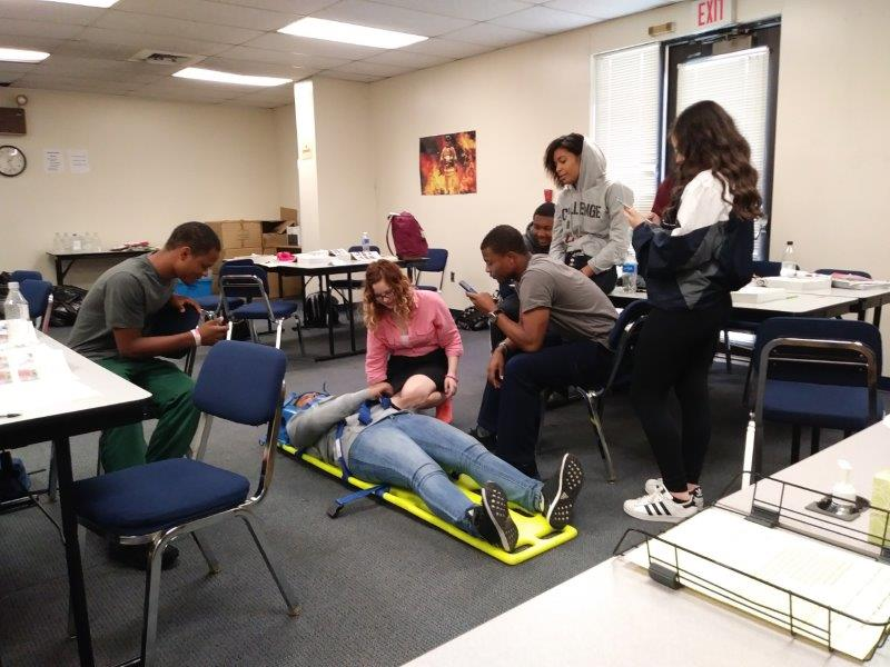 Classes of EMT, the students learning how to lift and move patients, learned body-mechanics and a safe delivery to a patient