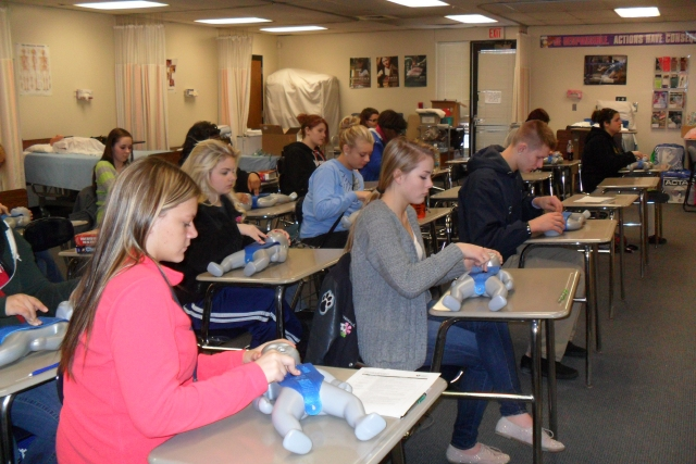 The students learning of CPR with their instructor