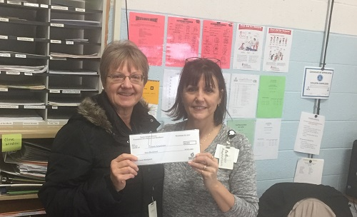 Caroline Patts presenting Colleen Ampezzan, PAES Lab Instructor, a $200.00 grant from the Taylor Public Schools Foundation for Educational Excellence.