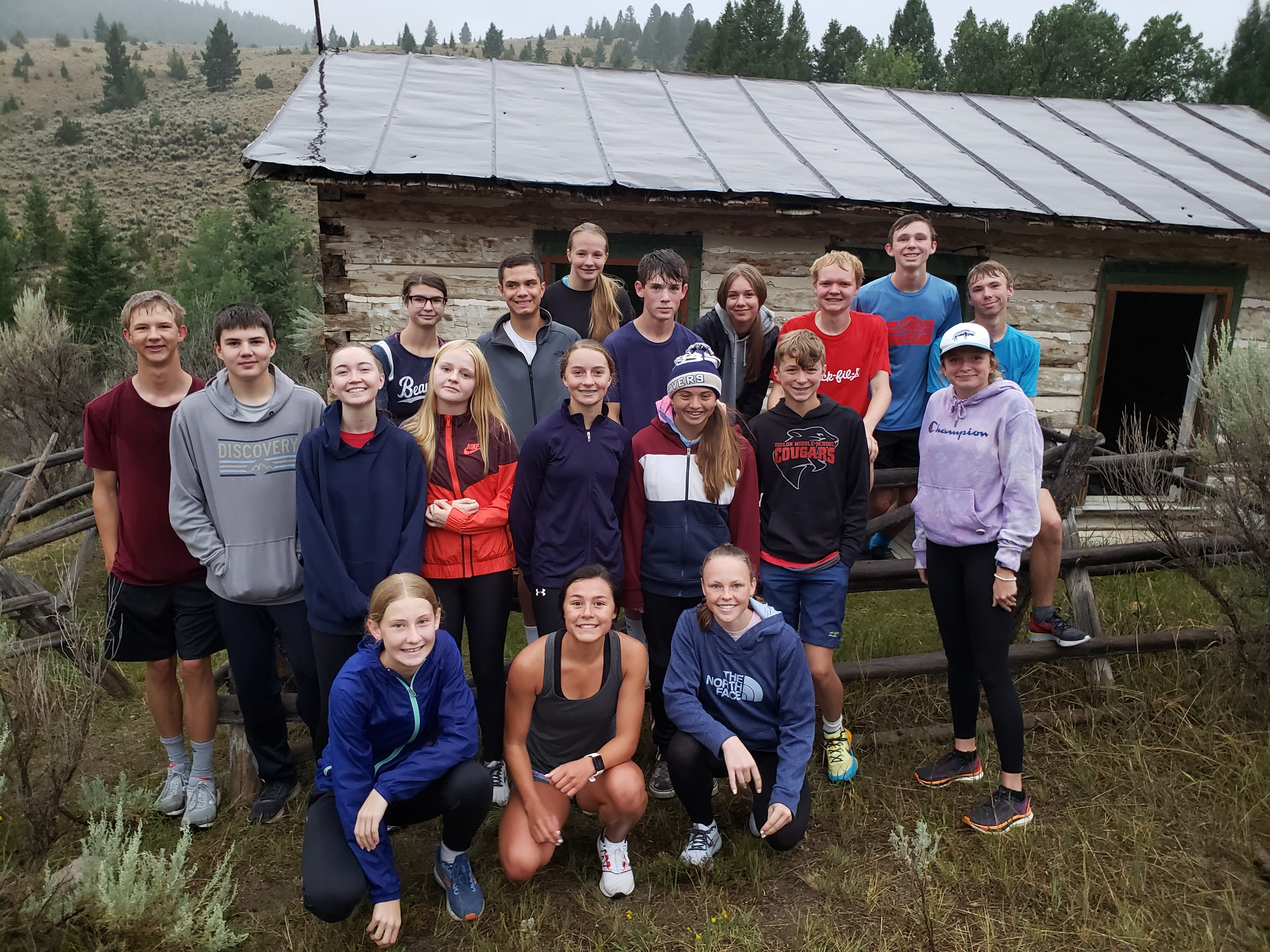 A photo of the Cross Country team outside