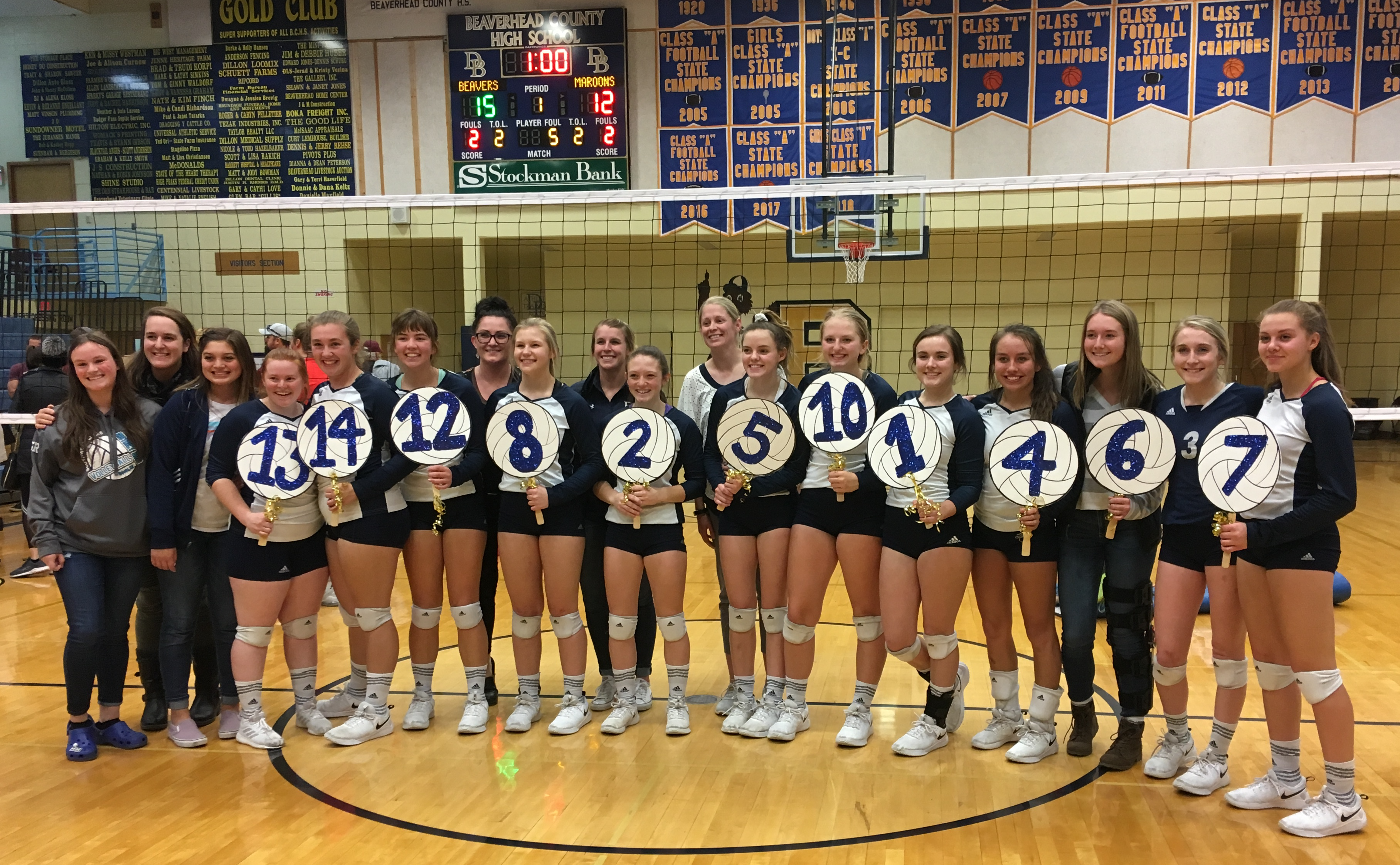 A photo of the Varsity volleyball team celebrating their third place finish at Districts in October 2019