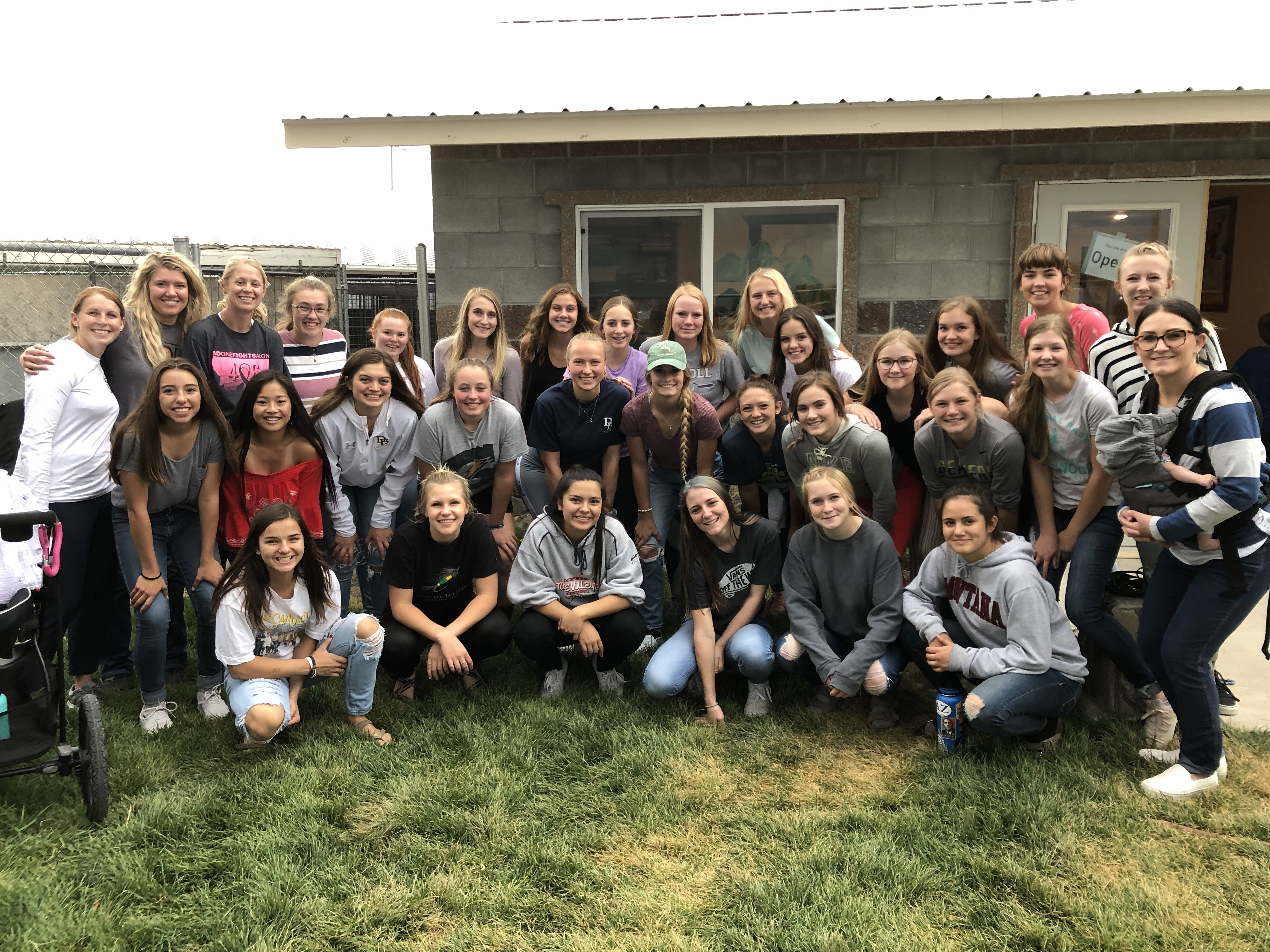 A photo of the volleyball team walking dogs at the local Humane Society in September 2019