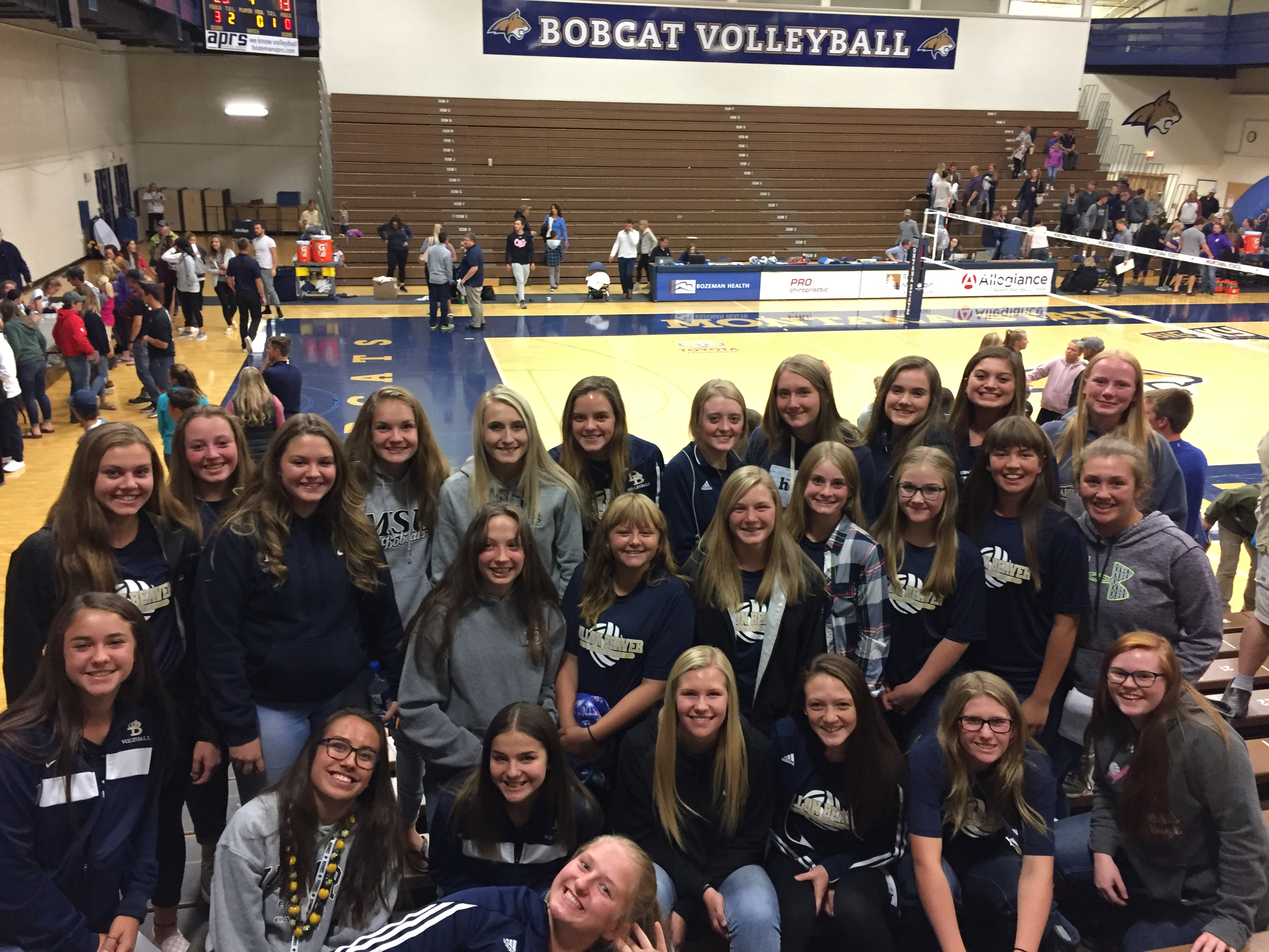 A photo of the volleyball team on a trip to watch the MSU Bobcats in August 2018