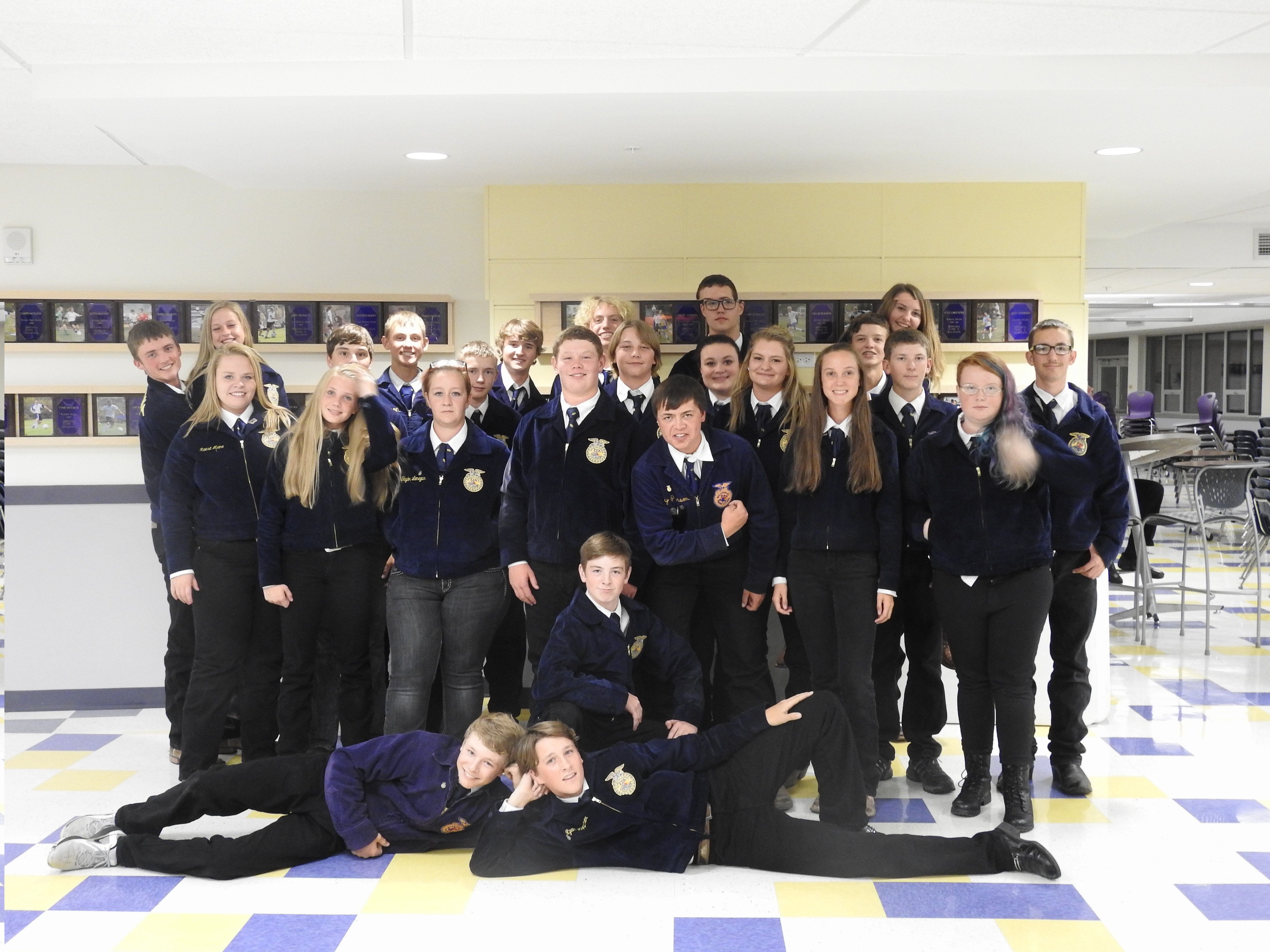A group photo of the FFA team posing in the school hallway