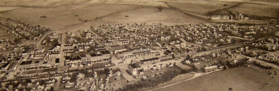 An old photo of an overhead view of a town