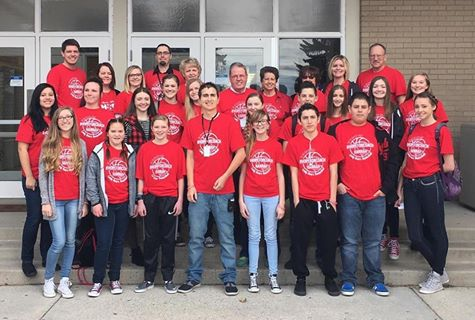 Photo of school staff and students.