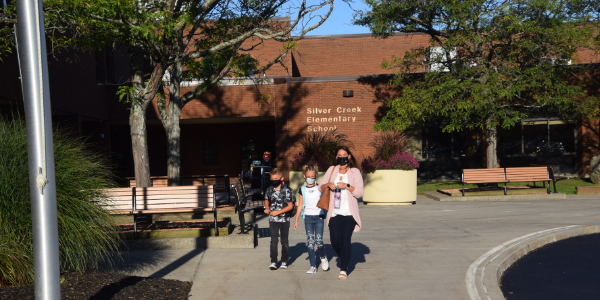 Students and staff walk in front of Silver Creek Elementary