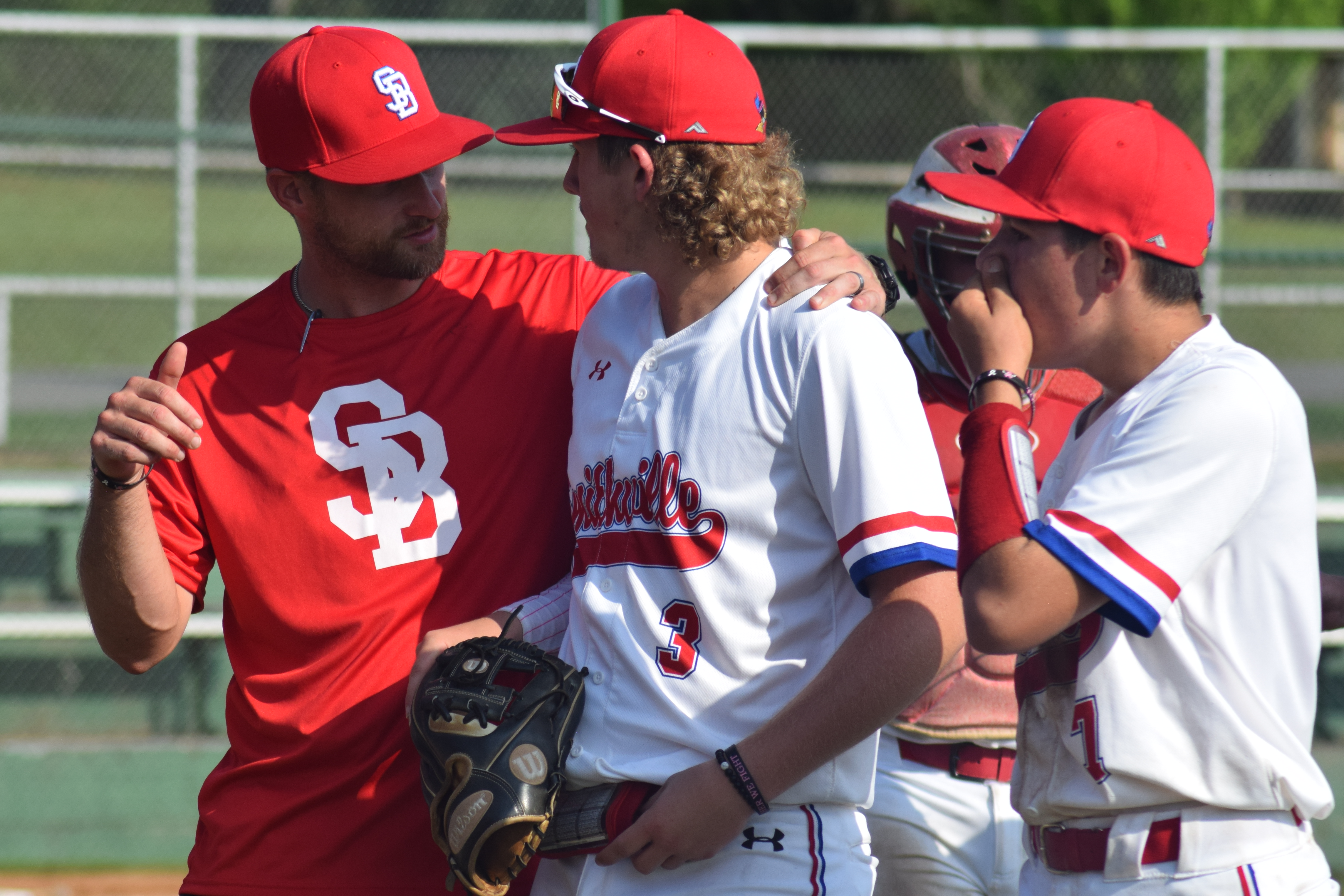 Baseball coach with players