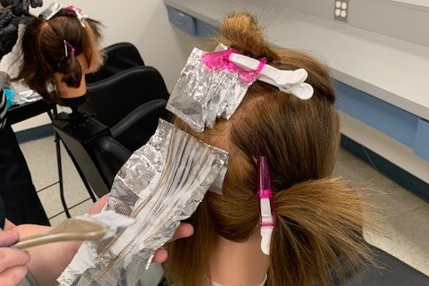 hands holding and foiling hair