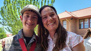 kid and teacher smiling