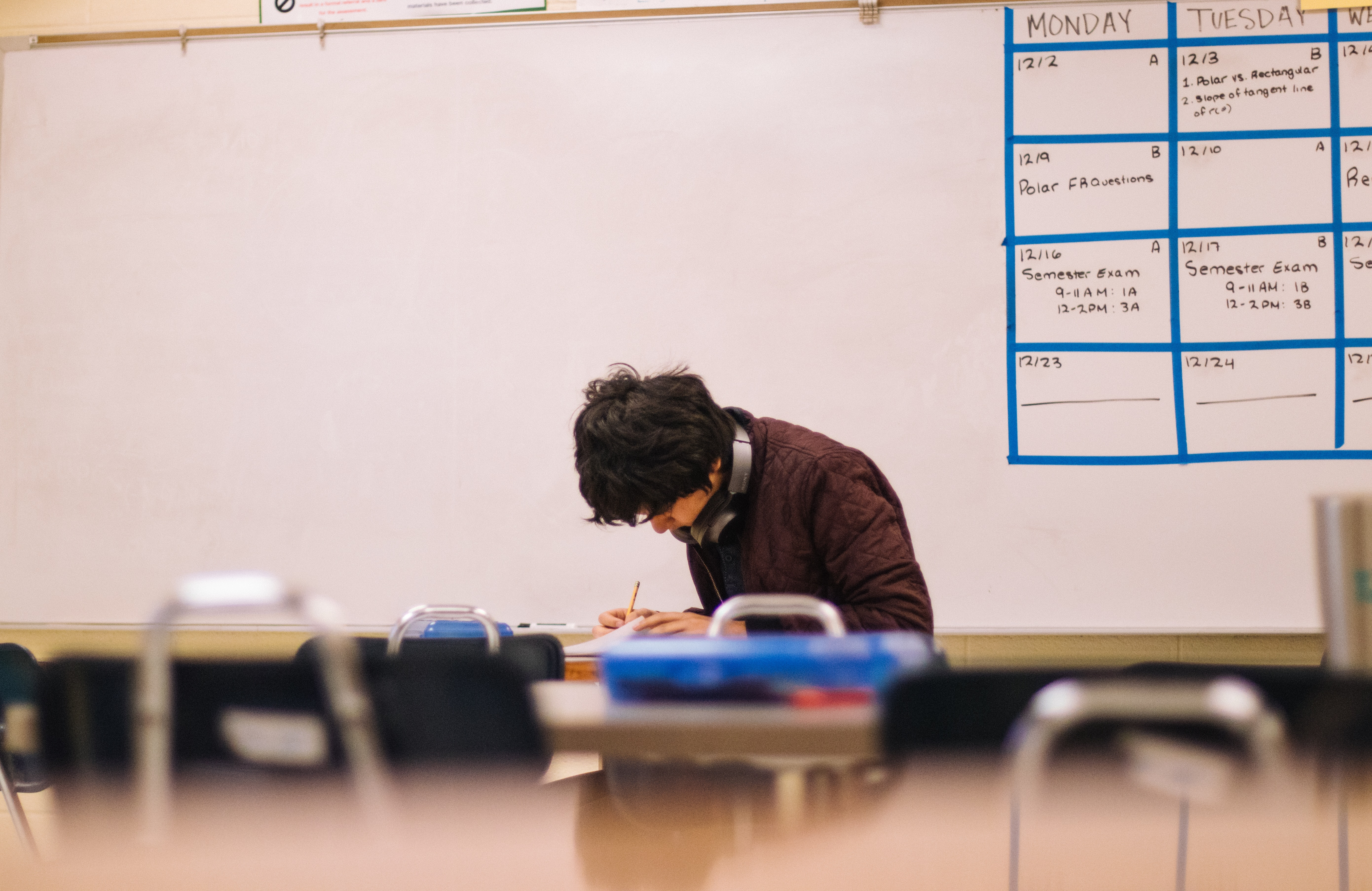 kid studying in class room