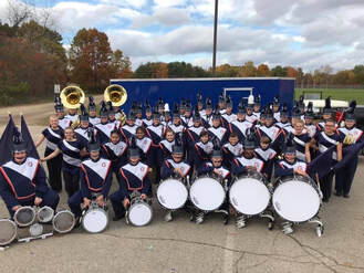 marching-band-group-photo-with-new-trailer