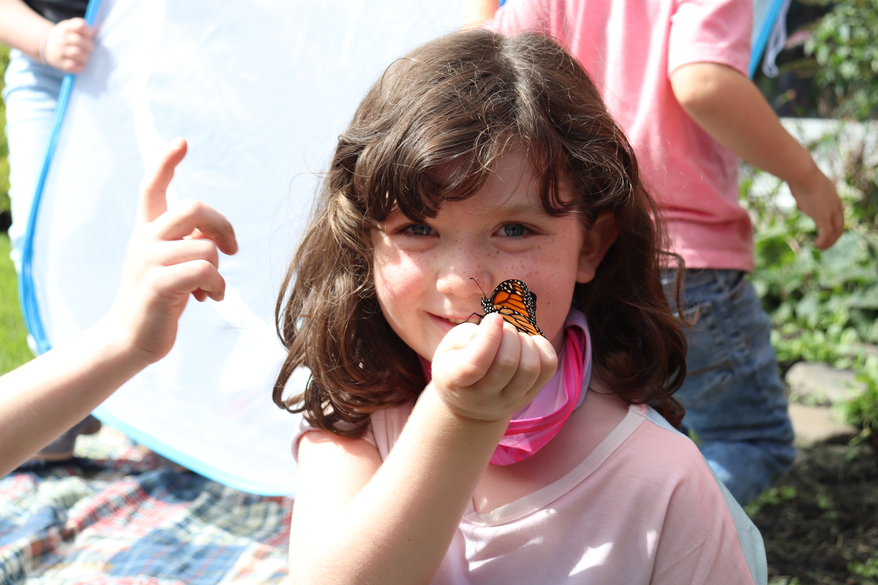 Student Holds Butterfly