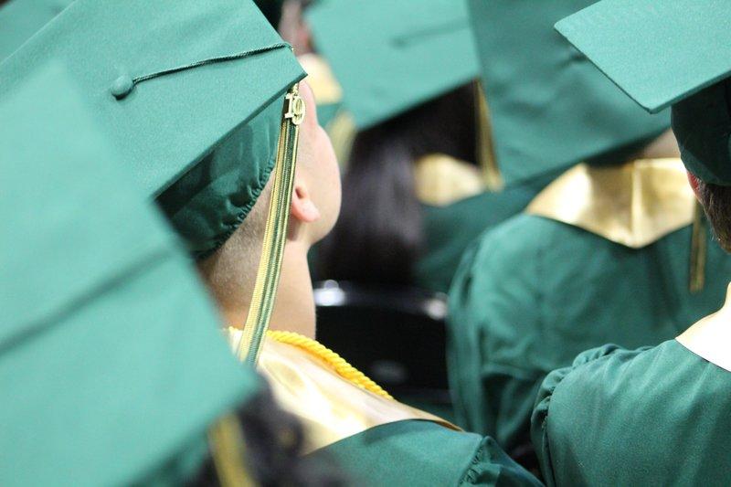 Senior students wearing their graduation caps