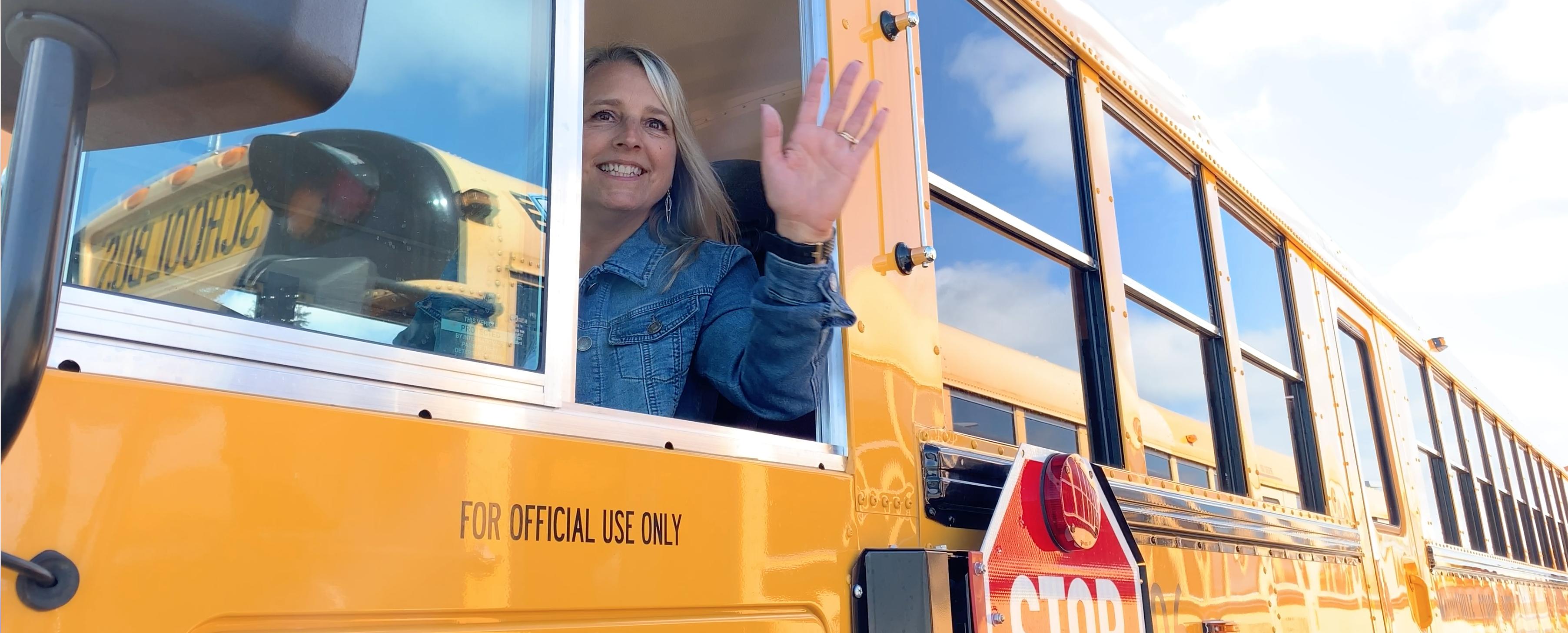 Yellow School Bus in front of the school