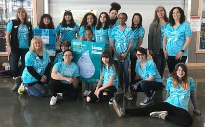 A group of girls dressed up in blue