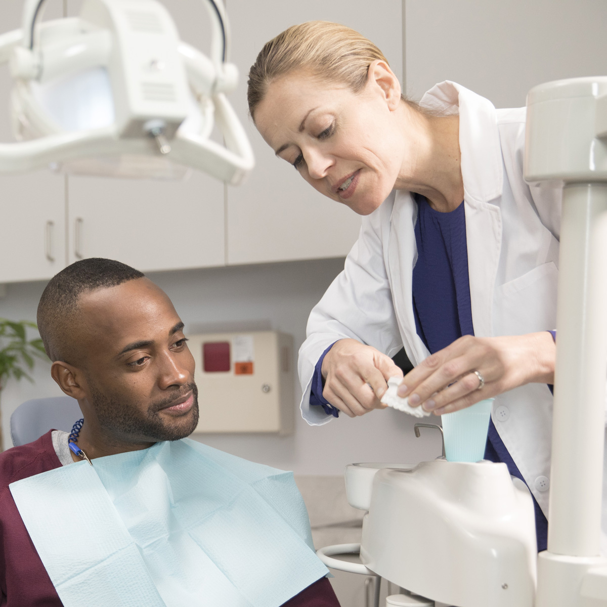 A photo of a dentist with her patient